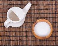 Ceramic neti pot and sea salt. In bowl royalty free stock photo