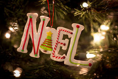 Ceramic noel. A close-up shot of a whimsical ceramic ornament spelling the word 'NOEL Stock Photography
