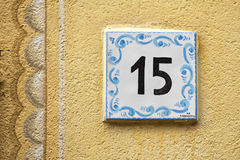 Ceramic number tile. 15 on italian old house Stock Images