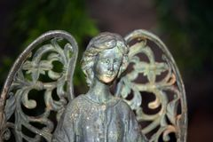 Ceramic Old Angel garden Background day light. Ceramic Old Angel summer garden Background day light stock photography