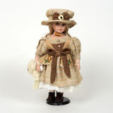 Ceramic old dolly. Ceramic very pretty old dolly Royalty Free Stock Image
