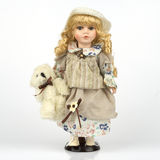 Ceramic old dolly. Ceramic very pretty old dolly Royalty Free Stock Images