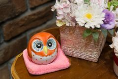 Ceramic owl flower guardian royalty free stock photo