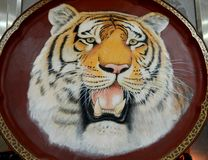 Ceramic painting tiger. Steller ceramic integrated use of a variety of glaze colors painting process, fine pen color Picture tiger's the beauty of vigorous Stock Images