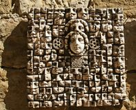 Ceramic panels depicting people's heads Royalty Free Stock Photo