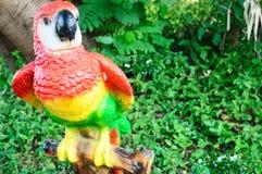 Ceramic Parrot in the garden. Colorful Ceramic Parrot in the garden royalty free stock photo