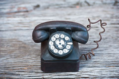 Ceramic phone on wood Royalty Free Stock Images