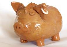 Ceramic piggy bank. Homemade ceramic piggy bank, view close up Stock Photo