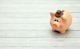 Ceramic pink piggy bank on wooden background, space for text royalty free stock photos