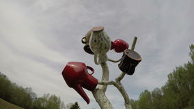 Ceramic pitcher jug jar colorful group  and clouds motion. Timelapse 4K stock video