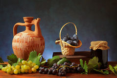 Ceramic pitcher and plums Stock Photos