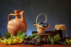 Ceramic pitcher and plums Stock Photos