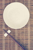Ceramic Plate And Wood Chopsticks Stock Photos
