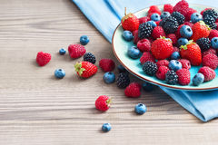 Ceramic plate of assortment berries blueberries, strawberries, raspberries, blackberries Stock Image