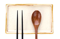 Ceramic Plate and chopsticks with wooden spoon ready for Asian f Stock Photography