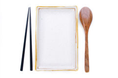 Ceramic Plate and chopsticks with wooden spoon ready for Asian f Royalty Free Stock Photos