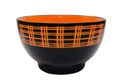 Ceramic plate. Deep ceramic plate in black and orange pattern Stock Photography