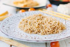 Ceramic plate filled by chinese rice noodles.  Stock Photography