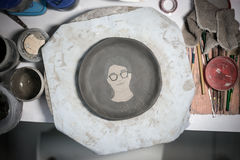 Ceramic plate has just finished painting Royalty Free Stock Photography