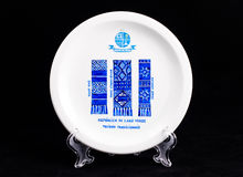 Ceramic plate with the national figure. Isolated on black Royalty Free Stock Image