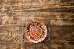 Ceramic Plate on Table Stock Photo
