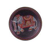 Ceramic plate with varnished elephant. Stock Images