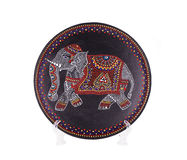 Ceramic plate with varnished elephant. Royalty Free Stock Photo