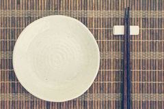 Ceramic plate and wood chopsticks Stock Photography