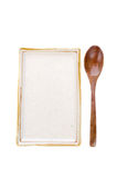 Ceramic Plate  with wooden spoon ready for Asian food . Royalty Free Stock Images