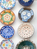 Ceramic plates. Several ceramic plates placed next to each other decorated with various details Royalty Free Stock Photography