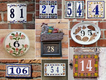 Ceramic plates. Ceramic numbers of houses in Bruges Stock Photos