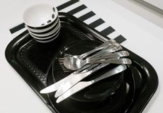 Ceramic Plates, Bowls and Cutlery on Tray Royalty Free Stock Photos