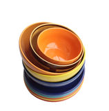 Pile of bright ware. Ceramic plates and bowls are put one on another Royalty Free Stock Image