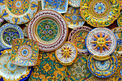 Ceramic plates in classic Sicilian style, Erice. Ceramic plates in the classic Sicilian style for sale outside of a souvenir shop in Erice, Sicily, Italy stock images