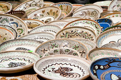 Ceramic plates exposed to market Stock Images