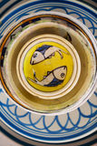 Ceramic plates. With fishes, yellow and blue. Old Stock Photo
