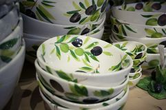 Ceramic plates. Traditional handmade tableware in a souvenir shop somewhere in Italy with olive decore Stock Images