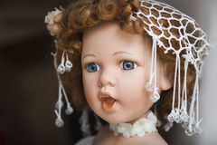 Ceramic porcelain handmade doll with big blue eyes and curly hair Stock Images