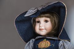 Ceramic porcelain handmade doll with big blue hat royalty free stock photo