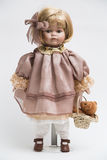 Ceramic porcelain handmade doll with blond hair and pink dress Royalty Free Stock Photography