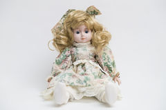 Ceramic porcelain handmade doll with long blond hair and floral dress Stock Image