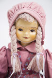 Ceramic porcelain handmade doll in pink vintage clothes Stock Photos