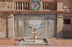 Ceramic Poster. Andalusian ceramic Poster depicting historic moments with little fountain Stock Photo