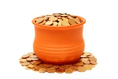 Ceramic pot with coins. Royalty Free Stock Photo