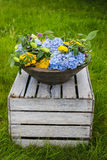 Ceramic pot with flowers in the garden Royalty Free Stock Photo