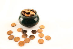 Ceramic pot full of coins Stock Photos