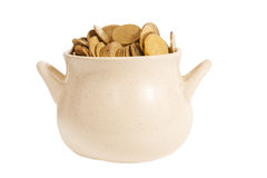 Ceramic pot with shiny coins isolated on white Stock Photo