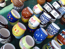 Ceramic Pots. Colorful designer ceramic clay pots for sale in pottery shop stock image