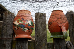 Ceramic pots on the fence Royalty Free Stock Image