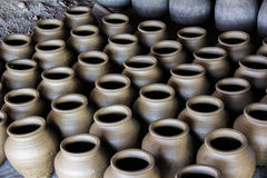 Ceramic pots. Rows of ceramic pots in a pottery stock photo